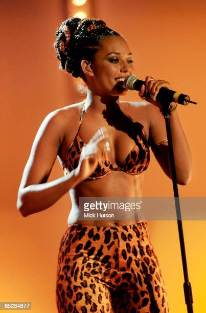 Photo of Mel B and SPICE GIRLS, Melanie Brown performing live on stage, leopard print