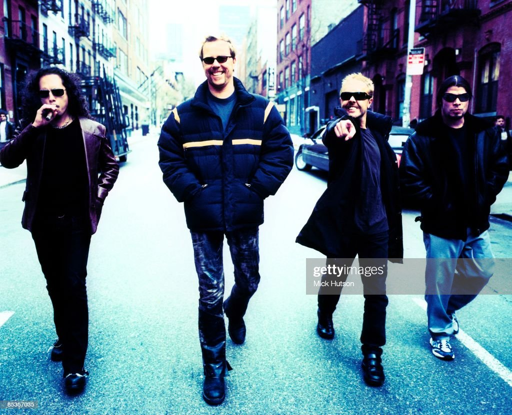 Photo of METALLICA and Lars ULRICH and James HETFIELD and Kirk HAMMETT and Robert TRUJILLO; Posed full length group portrait walking in the street L-R Kirk Hammett, James Hetfield, Lars Ulrich and Robert Trujillo, sunglasses, cigar, 322