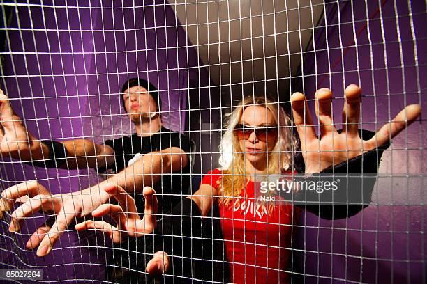 ASTORIA Photo of Michael AMOTT and Angela GOSSOW and ARCH ENEMY Col Posed Angela Gossow Michael Amott