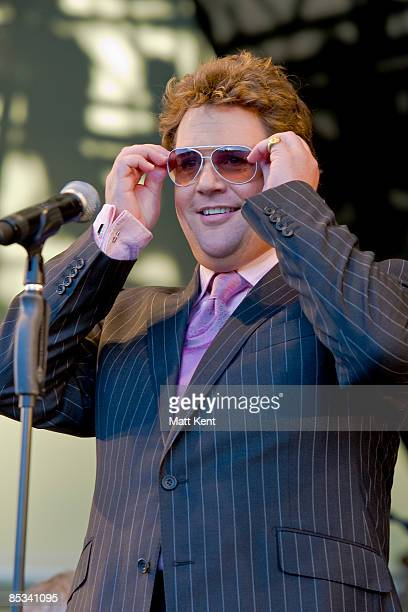 HOUSE Photo of Michael BALL Michael Ball performing on stage sunglasses
