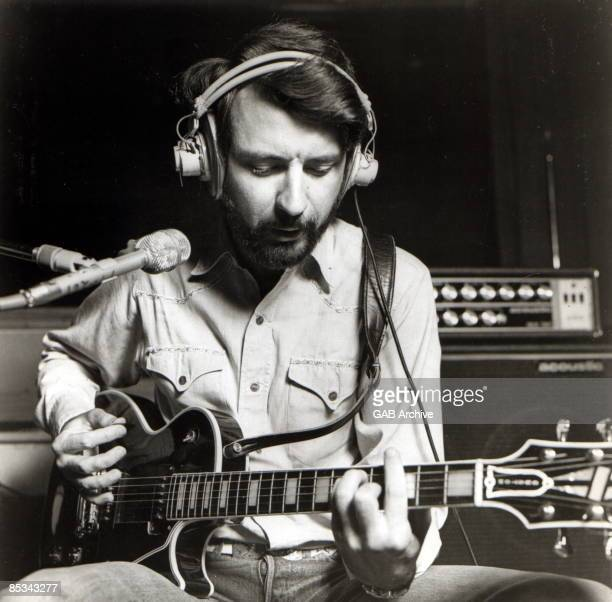 Photo of Michael NESMITH playing Gibson Les Paul in recording studio