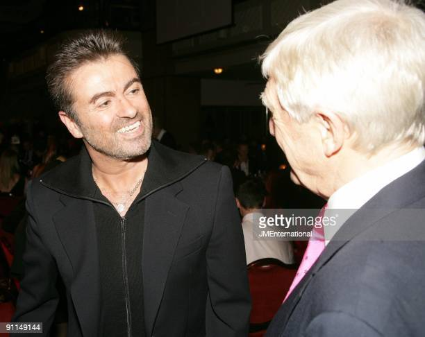 Photo of Michael PARKINSON and George MICHAEL and George MICHAEL LR George Michael Michael Parkinson at Music Industry Trust Dinner
