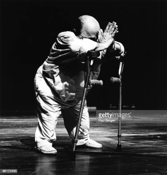 Photo of Michel PETRUCCIANI, Michel Petrucciani performing on stage, crutches, praying