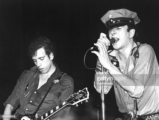 PALLADIUM Photo of Mick JONES and CLASH and Joe STRUMMER Joe Strummer Mick Jones performing live onstage at first US gig