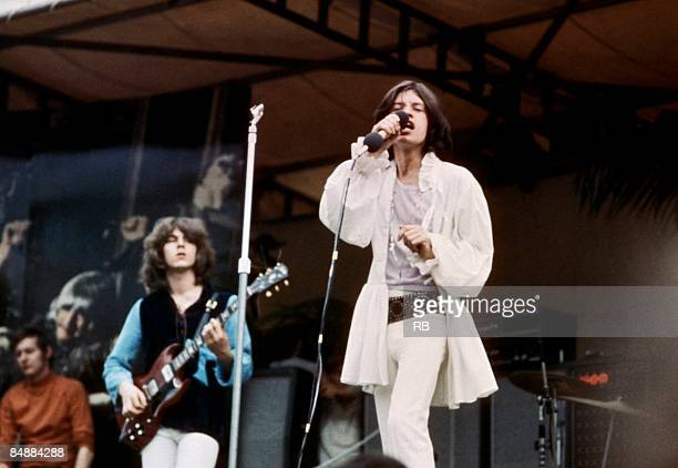 PARK Photo of Mick TAYLOR and ROLLING STONES and Mick JAGGER LR Mick Taylor and Mick Jagger performing live onstage at free Hyde Park concertBigsby...