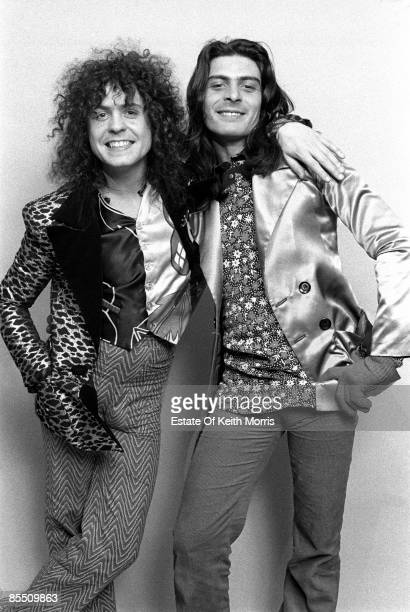 Photo of Mickey FINN and Marc BOLAN and T REX; Studio, posed L - R: Marc Bolan, Mickey Finn. Standing up, Marc Bolan with arm around Mickey Finn,...