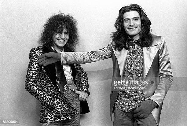 Photo of Mickey FINN and Marc BOLAN and T REX; Studio, posed L - R: Marc Bolan, Mickey Finn. Standing up, Finn holding arm outstretched in front of...