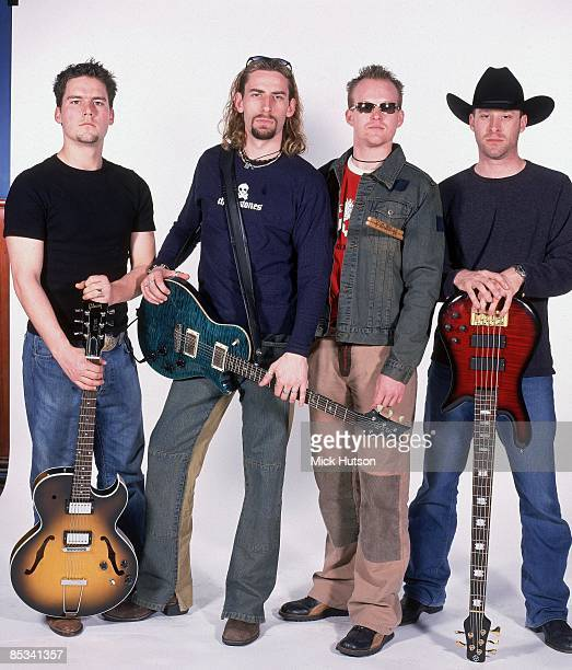 Photo of Mike KROEGER and NICKELBACK and Ryan PEAKE and Chad KROEGER and Ryan VIKEDAL LR Ryan Peake Chad Kroeger Ryan Vikedal Mike Kroeger posed...