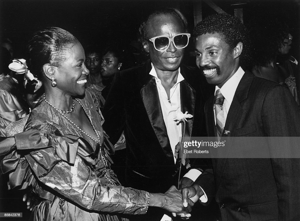 Photo of Miles DAVIS and KOOL & THE GANG and Robert Kool BELL and Cicely TYSON; Robert Bell 'Kool' of Kool and The Gang greeting Cicely Tyson and husband Miles Davis at a party at the Palace following the opening of 'Your Arms Are Too Short To Box With God' at the Alvin Theatre