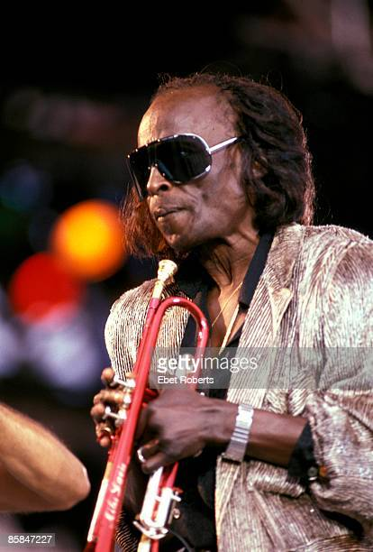 Photo of Miles DAVIS; performing live onstage at the Amnesty International Concert at Giant's Stadium in the Meadowlands Sports Complex, East...