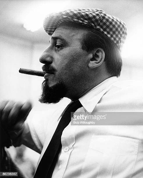 Photo of Mitch MILLER Posed portrait of Mitch Miller profile smoking cigar