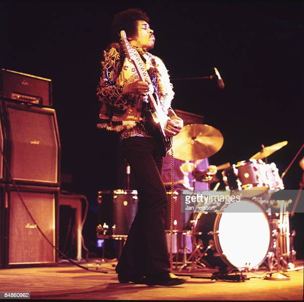 Photo of Mitch MITCHELL and Jimi HENDRIX with Mitch Mitchell behind performing live onstage at Falkoner Centret