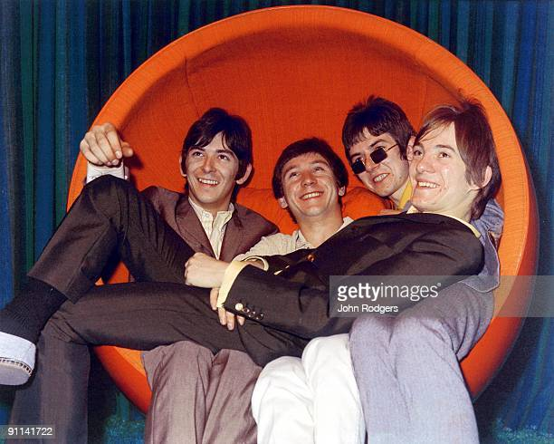 Photo of MODS and SMALL FACES; L-R: Ian McLagan, Kenney Jones, Ronnie Lane, Steve Marriott, posed, group shot, in 1960s chair