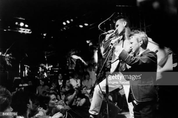 Photo of MORRISSEY and SMITHS Morrissey performing 'Panic' on The Tube TV show with child on vocals