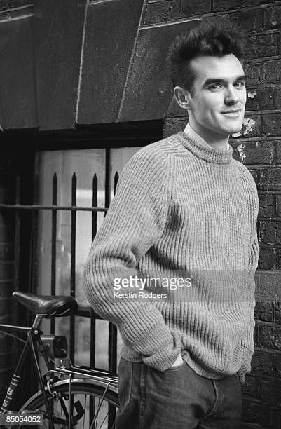 Photo of MORRISSEY and SMITHS Morrissey posed with bicycle
