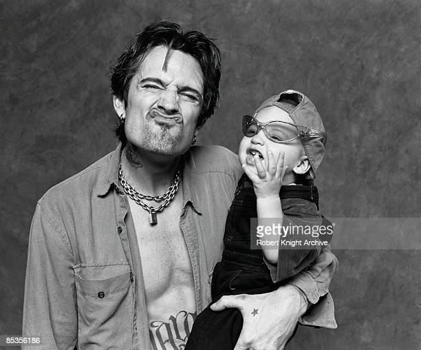 HOLLYWOOD Photo of MOTLEY CRUE and Tommy LEE Posed studio portrait of drummer Tommy Lee with son Brandon