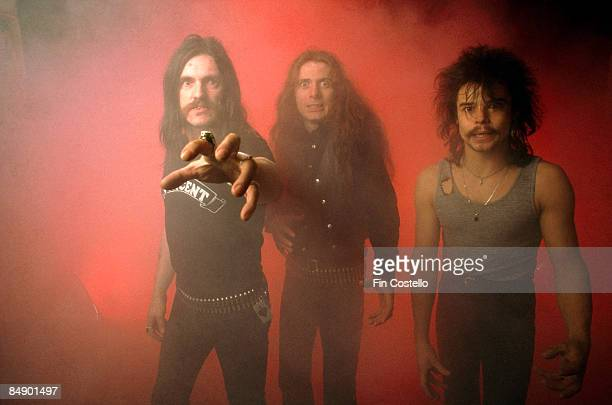 Photo of MOTORHEAD and LEMMY and Eddie CLARKE and Phil TAYLOR Posed studio group portrait LR Lemmy Eddie Clarke and Phil Taylor