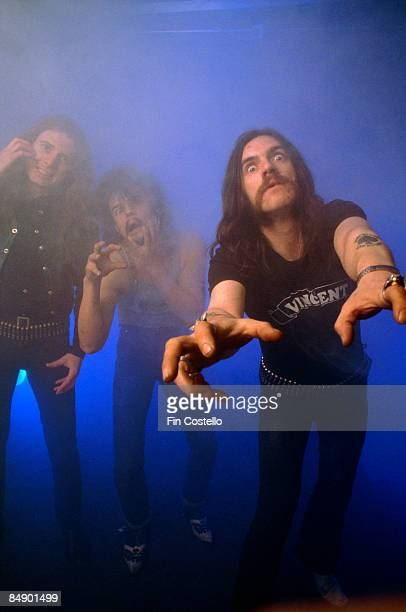 Photo of MOTORHEAD and LEMMY and Eddie CLARKE and Phil TAYLOR Posed studio group portrait LR Eddie Clarke Phil Taylor and Lemmy