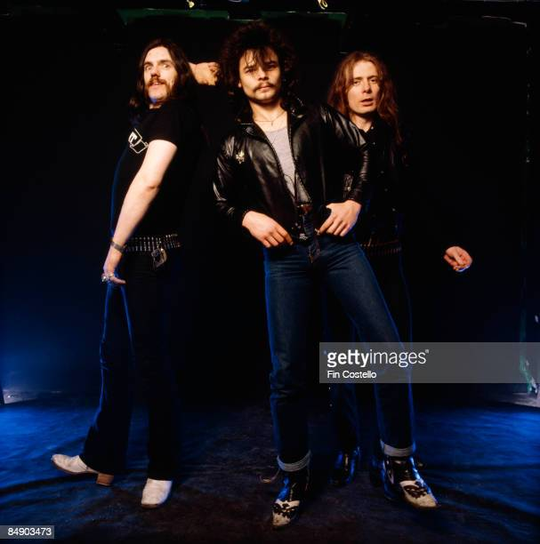 Photo of MOTORHEAD and LEMMY and Phil TAYLOR and Eddie CLARKE Posed studio group portrait LR Lemmy Phil Taylor and Eddie Clarke