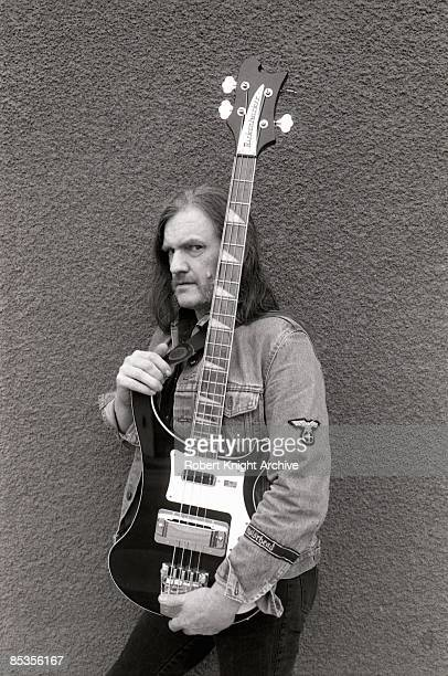 Photo of MOTORHEAD and LEMMY, Posed studio portrait of Ian 'Lemmy' Kilmister with a Rickenbacker bass guitar