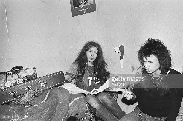 Photo of MOTORHEAD 'Fast' Eddie Clarke and Phil 'Philthy Animal' Taylor backstage at the Electric Circus smoking