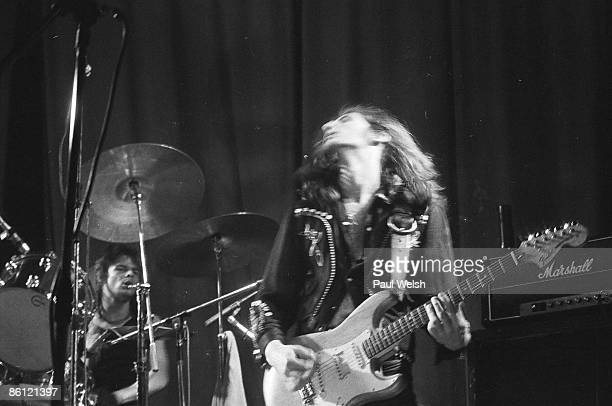 Photo of MOTORHEAD 'Fast' Eddie Clarke performing on stage at the Electric Circus