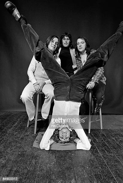 Photo of MUD and Rob DAVIS and Les GRAY and Ray STILES and Dave MOUNT Posed studio group portrait LR Les Gray Ray Stiles Dave Mount and Rob Davis...