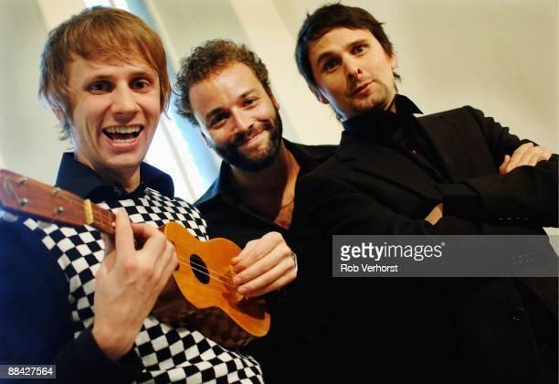 Photo of MUSE; L-R. Dominic Howard, Chris Wolstenholme, Matt Bellamy