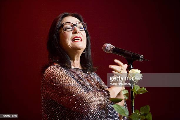 Photo of Nana MOUSKOURI, Nana Mouskouri performing live on stage during her farewell tour, with rose