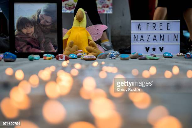 Photo of Nazanin Zaghari-Ratcliffe and her daughter Gabriella is seen amongst candles during a fourth birthday vigil for Gabriella opposite the...