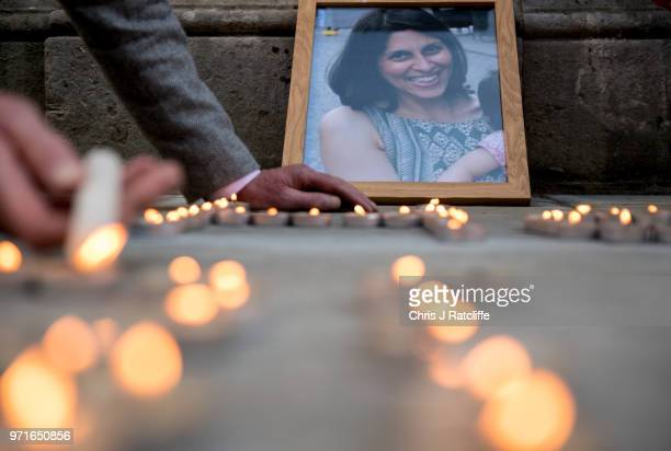 Photo of Nazanin Zaghari-Ratcliffe is seen amongst candles during a fourth birthday vigil for her daughter Gabriella opposite the Foreign &...