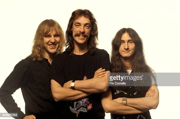 Photo of Neil PEART and RUSH and Alex LIFESON and Geddy LEE LR Alex Lifeson Neil Peart Geddy Lee posed studio group shot