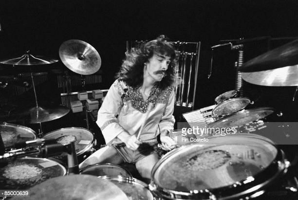 BIRMINGHAM Photo of Neil PEART and RUSH Neil Peart performing live onstage playing drums at the Odeon on A Farewell To Kings Tour