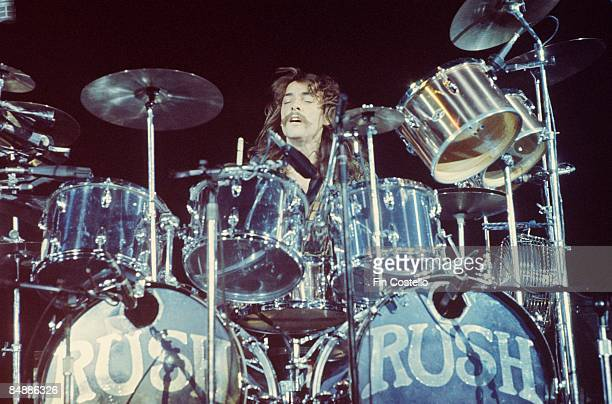 Photo of Neil PEART and RUSH Neil Peart performing live onstage on All The World's A Stage tour