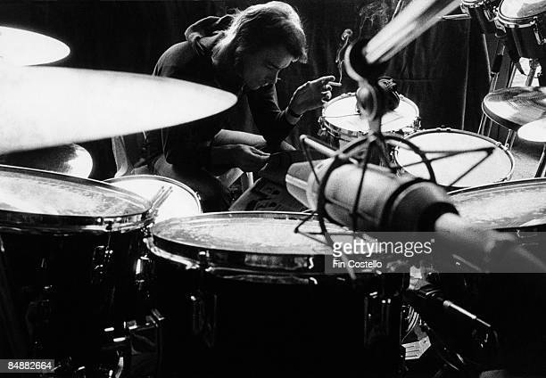 Photo of Neil PEART and RUSH Neil Peart playing drums in the recording studio during the making of Permanent Waves