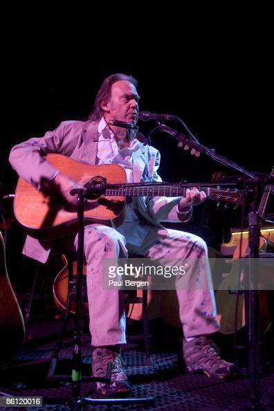photo of neil young neil young performing on stage acoustic guitar news photo getty images. Black Bedroom Furniture Sets. Home Design Ideas