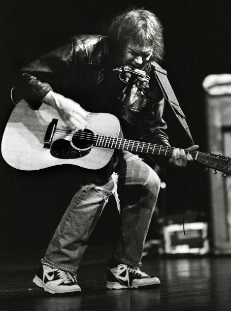 musician neil young turns 65 photos and images getty images. Black Bedroom Furniture Sets. Home Design Ideas