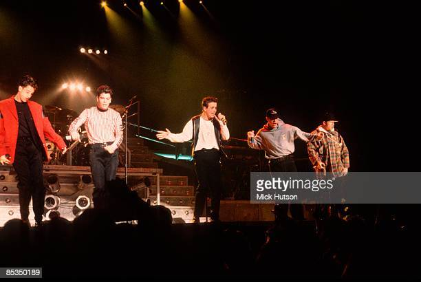 Photo of NEW KIDS ON THE BLOCK and Joey McINTYRE and Donnie WAHLBERG and Jonathan KNIGHT and Jordan KNIGHT and Danny WOOD Group performing on stage...