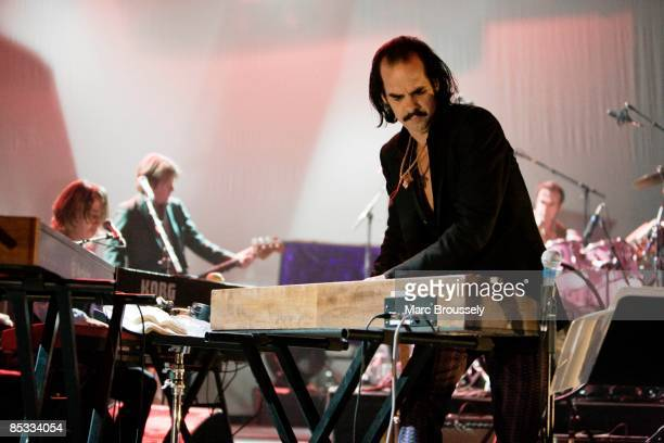Photo of Nick CAVE and Nick CAVE & THE BAD SEEDS, Nick Cave performing on stage, keyboards