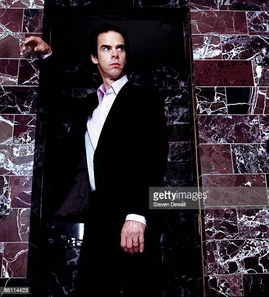Photo of Nick CAVE Posed studio portrait of Nick Cave