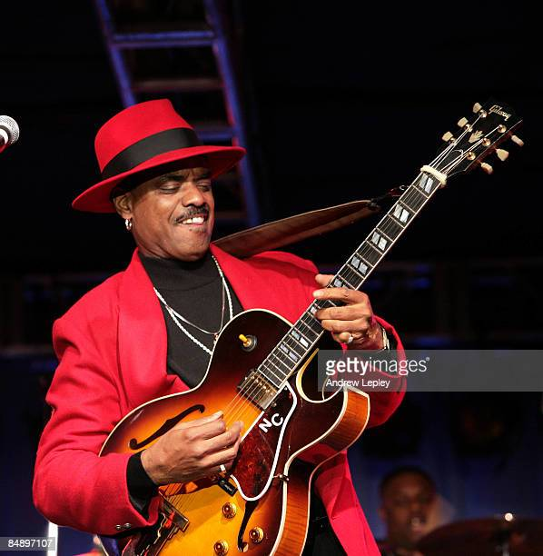 Photo of Nick COLIONNE Performing live onstage wearing red suit and red hat