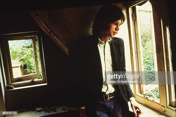 Photo of Nick DRAKE posed 'Five Leaves Left' cover shot