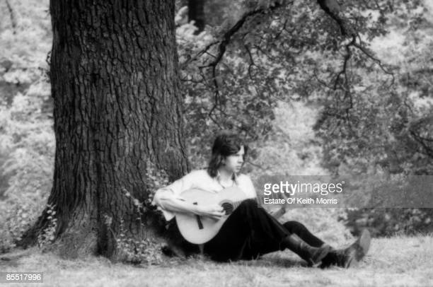 HAMPSTEAD Photo of Nick DRAKE Posed portrait of Nick Drake with guitar