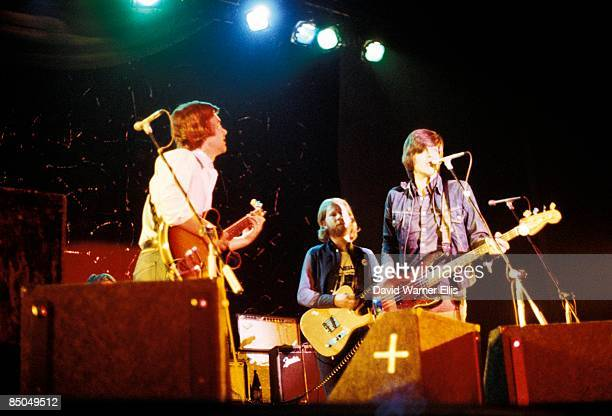 Photo of Nick LOWE and BRINSLEY SCHWARZ and Ian GOMM, L-R: Brinsley Schwarz, Ian Gomm, Nick Lowe - performing live onstage, supporting Wings