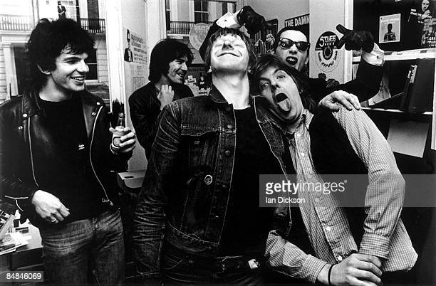 Photo of Nick LOWE and Jake RIVIERA and DAMNED Posed in Stiff Records with Nick Lowe Jake Riviera