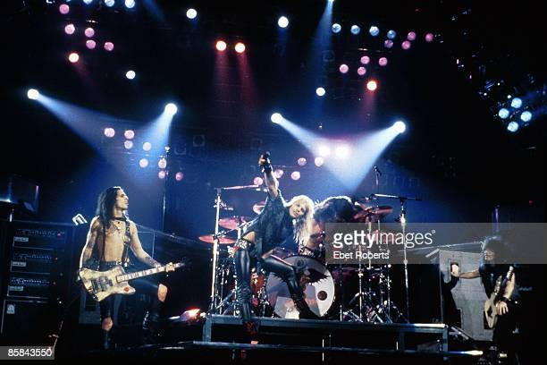 UNITED STATES JANUARY 01 USA Photo of Nikki SIXX and Vince NEIL and Mick MARS and MOTLEY CRUE Perfoming live on stage L R Mick Mars Vince Neil Nikki...