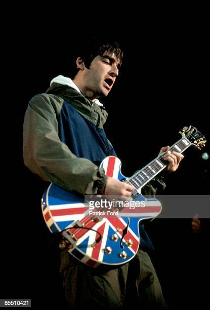 Photo of Noel GALLAGHER and BRITPOP and OASIS Noel Gallagher performing live onstage playing Epiphone Union Jack guitar at Maine Road Britpop