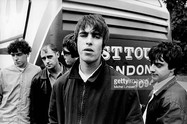 Photo of Noel GALLAGHER and Liam GALLAGHER and OASIS, L-R: Tony McCarroll, Paul 'Bonehead' Arthurs, Noel Gallagher, Liam Gallagher, Paul 'Guigsy'...