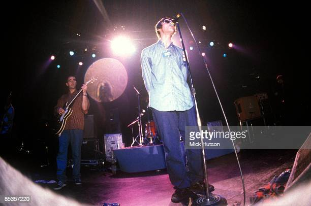 """Photo of OASIS and Liam GALLAGHER and Paul Bonehead ARTHURS; Paul """"Bonehead"""" Arthurs and Liam Gallagher performing on stage"""