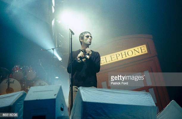 COURT Photo of OASIS and Liam GALLAGHER Liam Gallagher performing on stage telephone box
